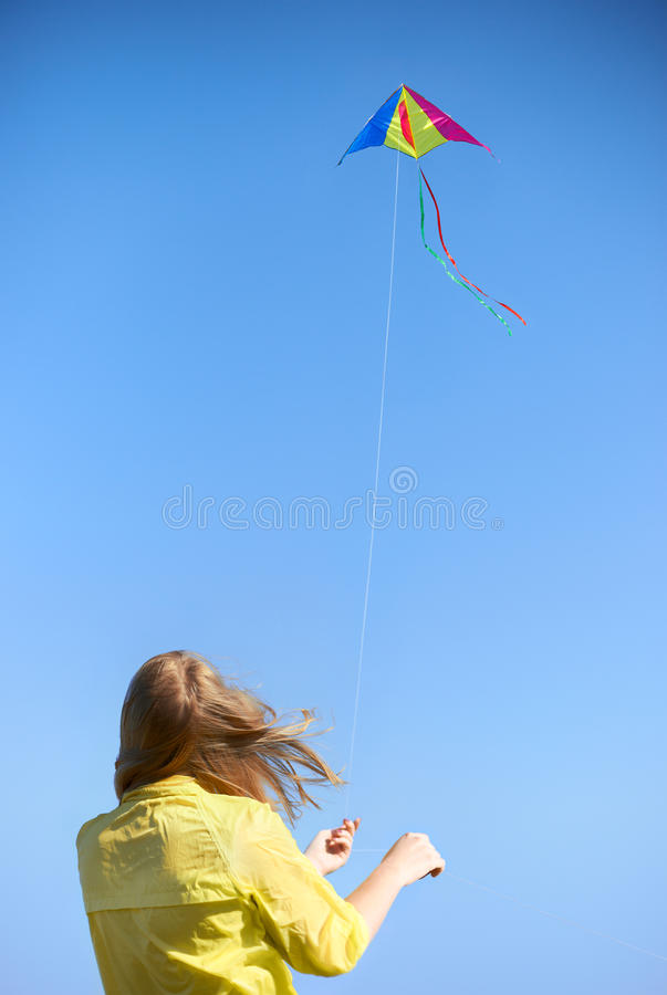 Kite and Girl royalty free stock image