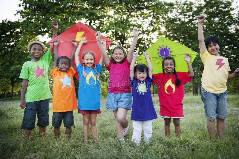 Kite Kid Child Casual Cheerful Leisure Outdoors Concept. Diverse Kid Child Casual Cheerful Leisure Outdoors Kites stock photos