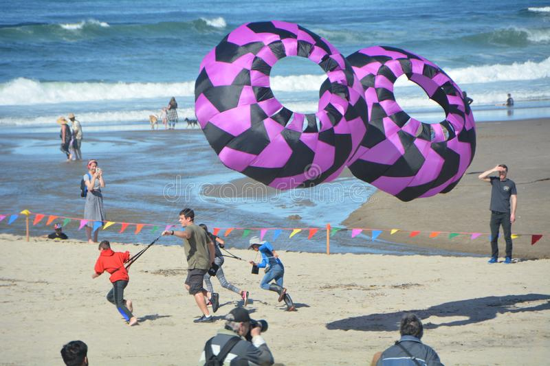 Kite race on the Oregon coast at Lincoln City. The Lincoln City Kite Festival takes place twice a year, in summer June and fall October, at the D-River Wayside stock photography