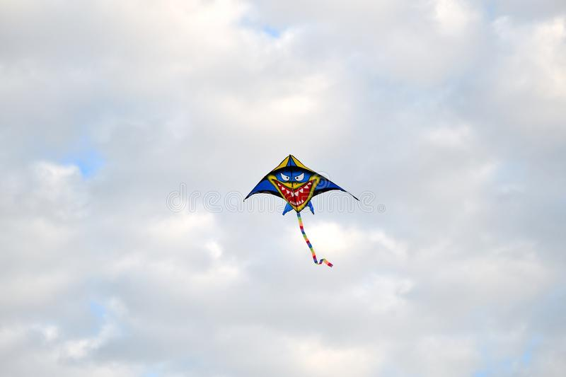 Kite Several Colors Tracing Over Sky royalty free stock image