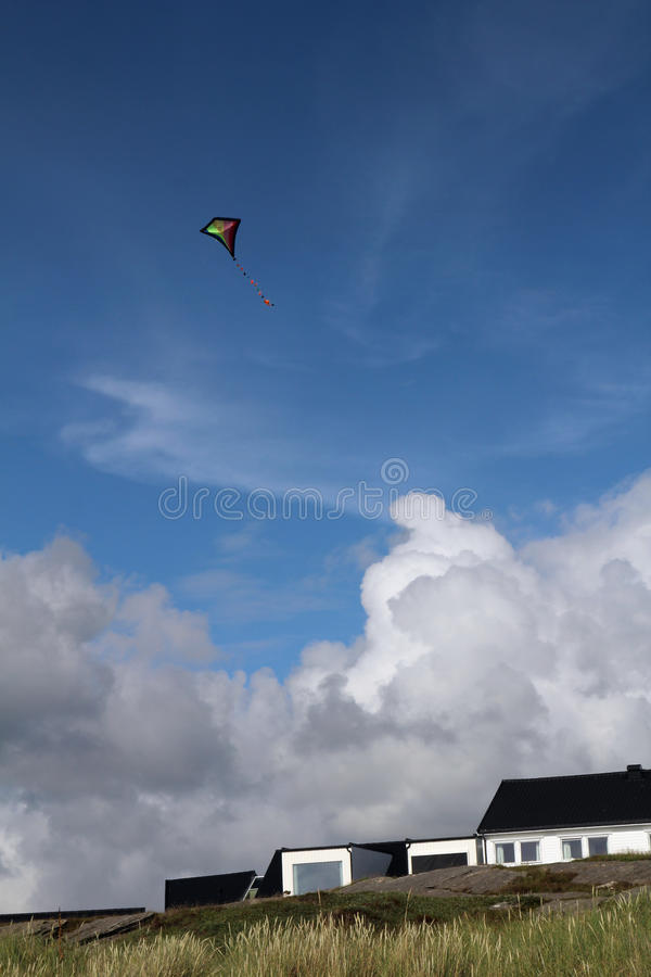 A kite at the Sola beach near Stavanger, Norway. Flying kite at the Sola beach near Stavanger, Norway royalty free stock photography