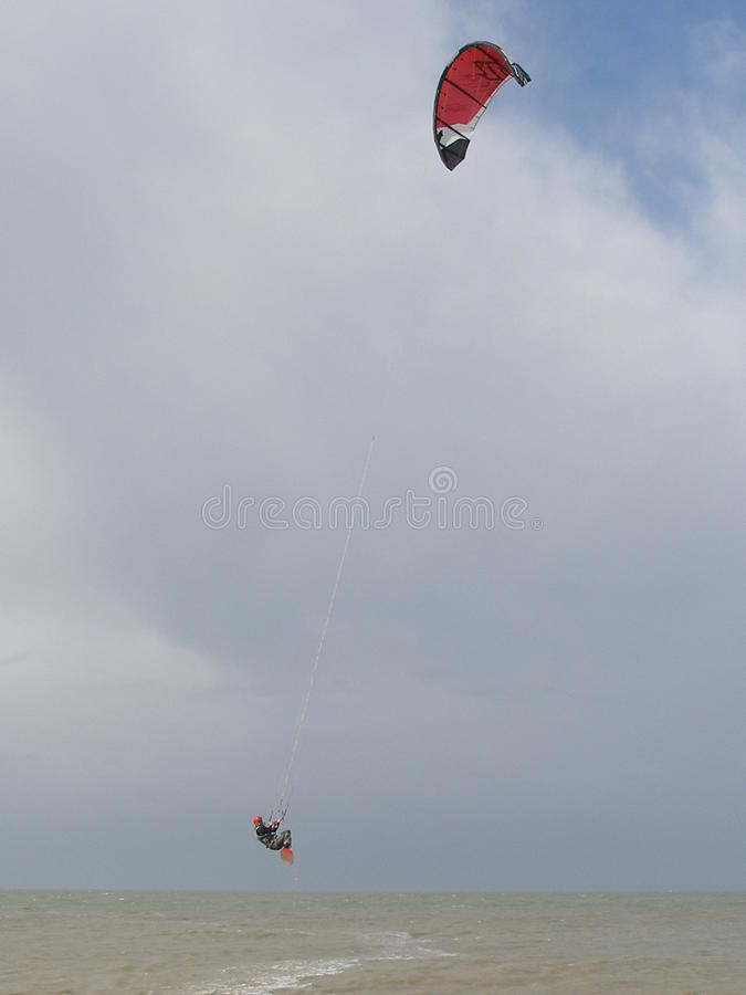 Kite Surf. Kitesurfer jumps up in the air stock photo