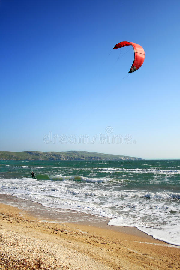 Kite surf. Kite-surfer on the waves royalty free stock photos