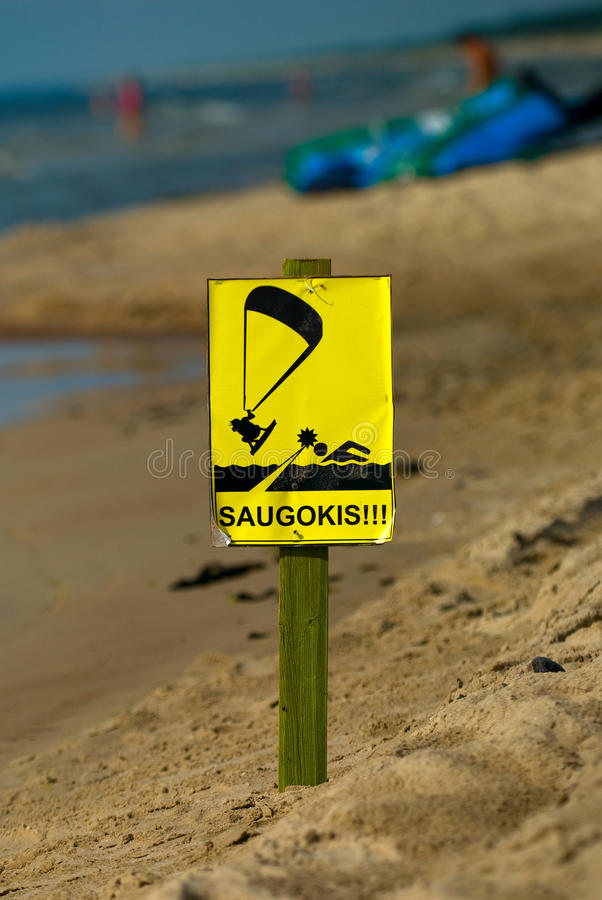 Kite surf. Traffic sign on the beach stock images