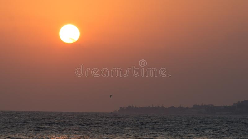 Kite surf under a big sun in marbella royalty free stock image