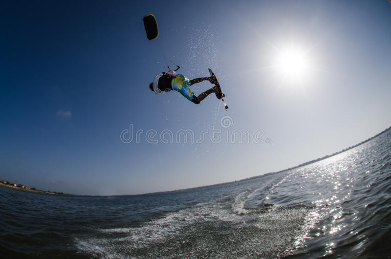 Kite Surfer. Kiteboarder flying over the water on a sunny day stock images