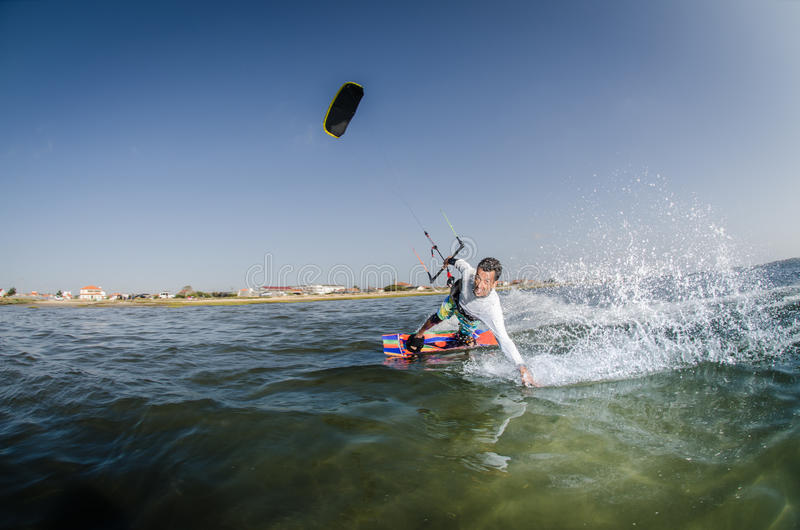 Kite Surfer. Kiteboarder enjoy surfing on a sunny day stock images