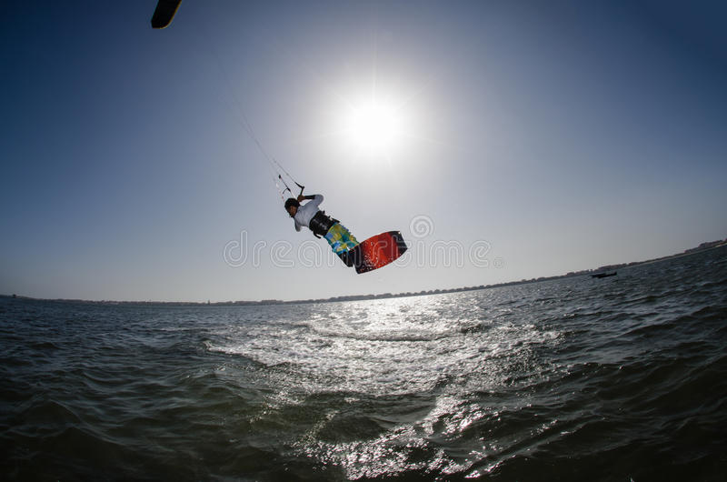 Kite Surfer. Kiteboarder enjoy surfing on a sunny day royalty free stock image