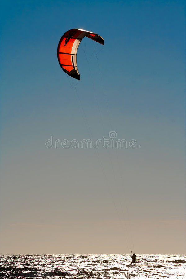 Kite surfer. Evening bright sun stock images