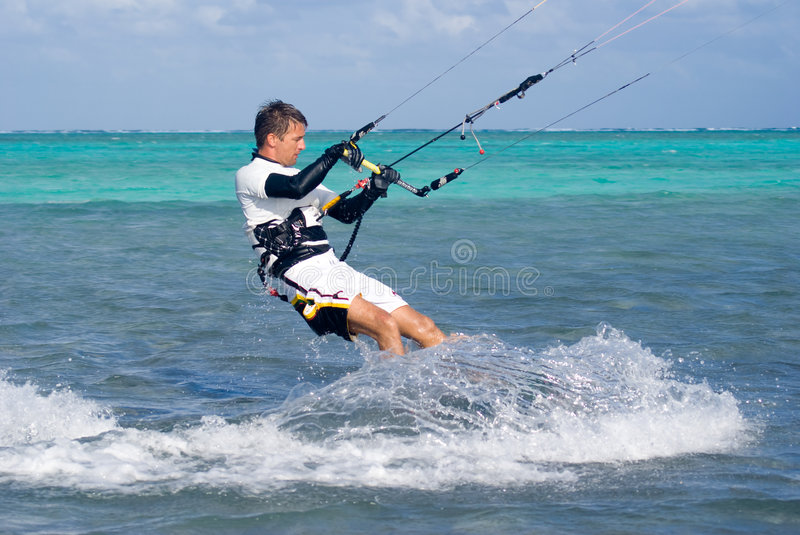 Kite Surfer. Male Kite surfer enjoying his sport in Grand Cayman royalty free stock photo