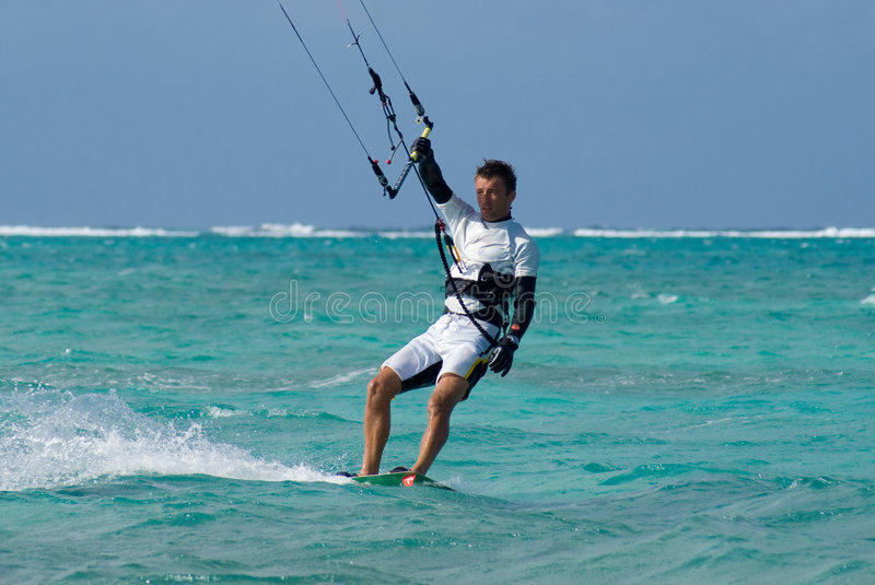 Kite Surfer. Male Kite surfer enjoying his sport in Grand Cayman royalty free stock photos