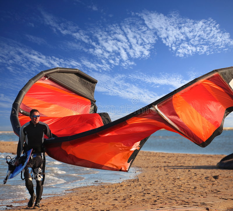 Kite surfer on the beach. Fun and adventure with the kite and board stock image