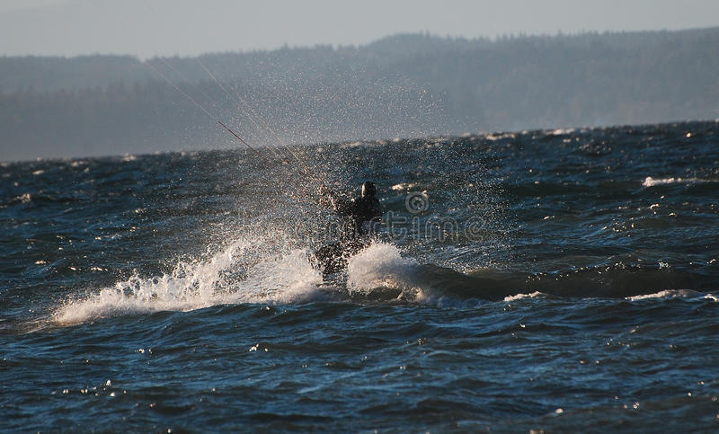 Kite surfer changing course royalty free stock photos