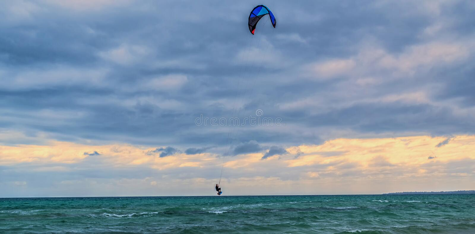 Kite surfer is flying royalty free stock images