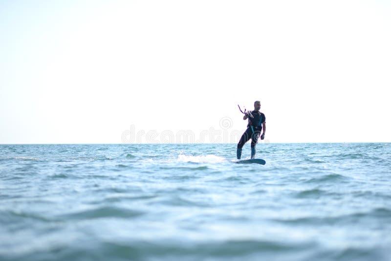 Kite surfing man practicing. stock photos