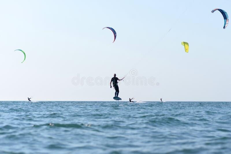 Kite surfing man practicing. royalty free stock photos
