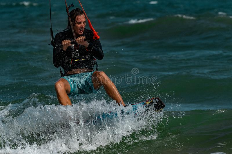 Kite surfer. Rides the waves stock images