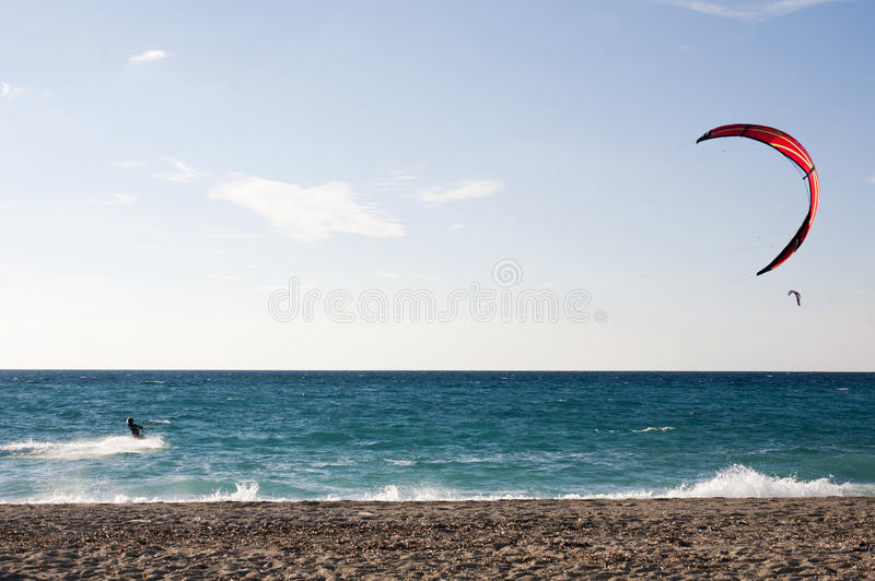 Kite surfer. Sportsman kite surfer in summer day stock images