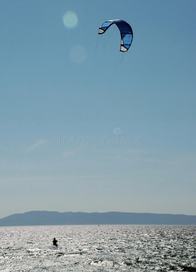 Kite surfer in the sun stock images
