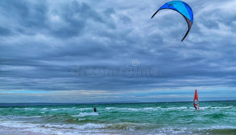 Kite surfer and wind surfer royalty free stock photos