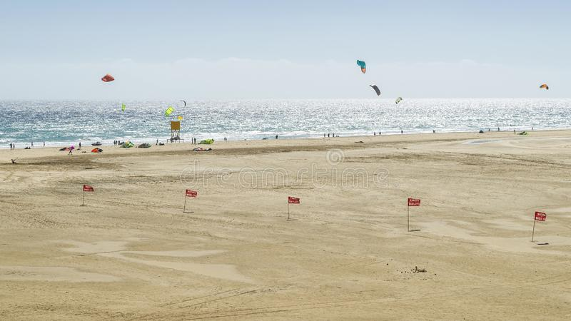 Kite surfers in action on the beautiful sandy beach Playa de Sotavento in Fuerteventura, Canary Islands, Spain royalty free stock photos