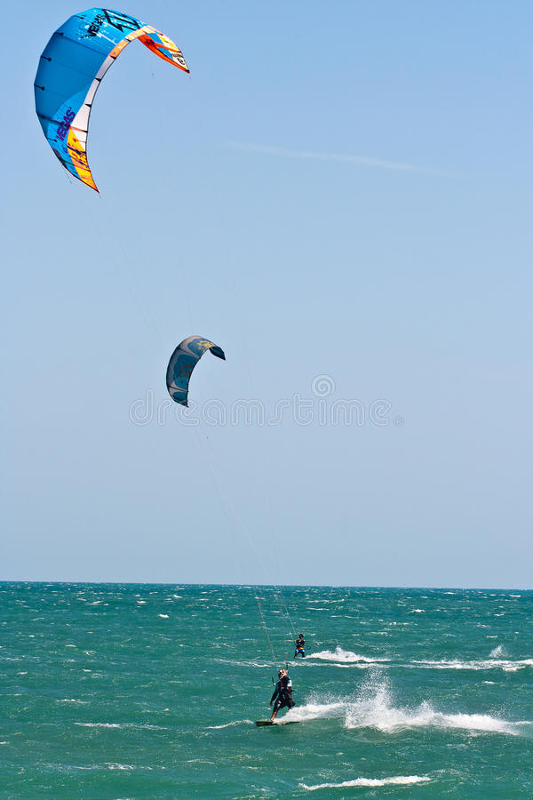 Kite surfers on a choppy sea stock photo