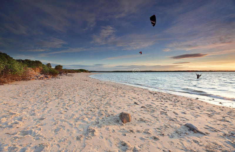 Kite Surfers at sunset on Silver Beach, Botany Bay Australia. Late afternoon light as the sun sets at Silver Beach Botany Bay, Kite surfers in the water stock photos