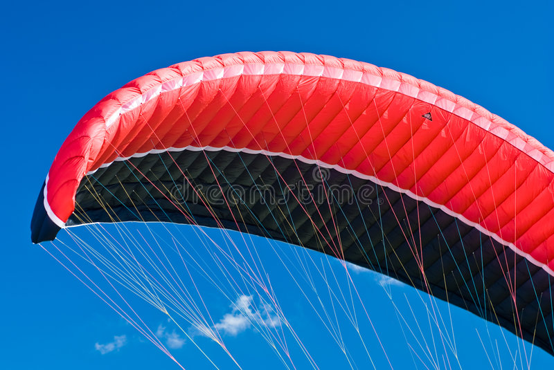 Kite Surfing. The fly of a kiteboarder royalty free stock photo