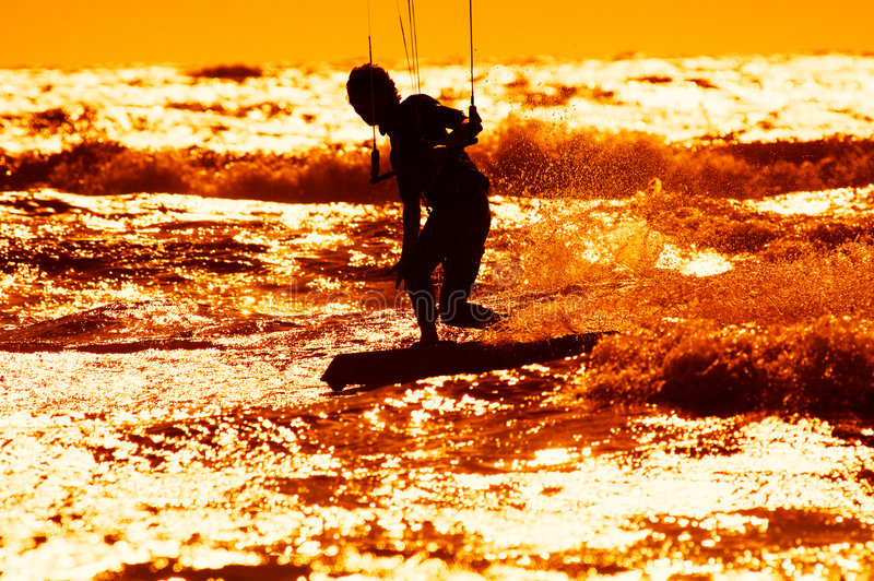 Kite surfing. Kite boarder action with sunset stock photos