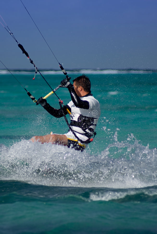 Kite Surfing. Male Kite surfer enjoying his sport in Grand Cayman royalty free stock photography