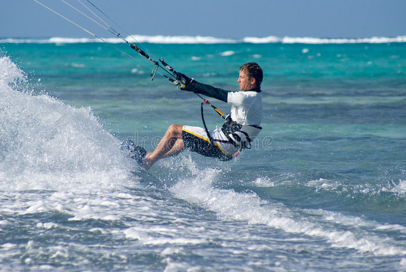 Kite Surfing. Male Kite surfer enjoying his sport in Grand Cayman royalty free stock photos