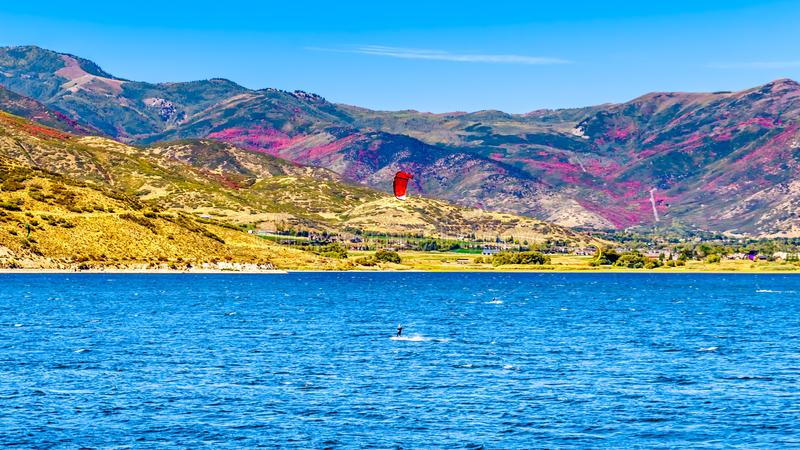 Kite Surfing on Deer Creek Reservoir near Provo. Provo, Utah/United States - Sept. 26, 2019: Kite Surfing on Deer Creek Reservoir near Provo, surrounded by Fall royalty free stock images