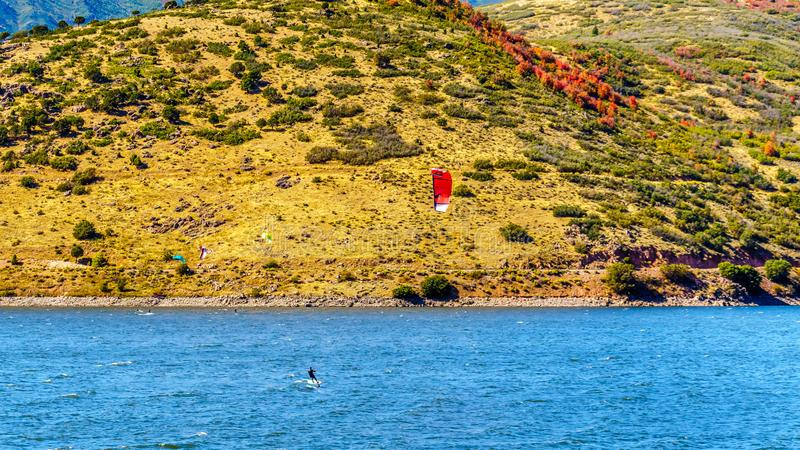 Kite Surfing on Deer Creek Reservoir near Provo. Provo, Utah/United States - Sept. 26, 2019: Kite Surfing on Deer Creek Reservoir near Provo, surrounded by Fall royalty free stock photography