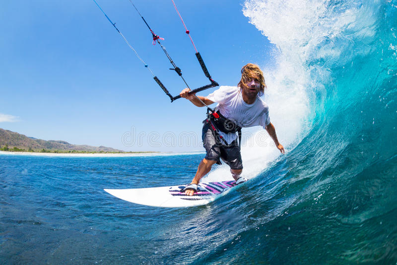 Kite Surfing. Extreme Sport, Kite Surfer Riding Wave getting Barreled stock photos