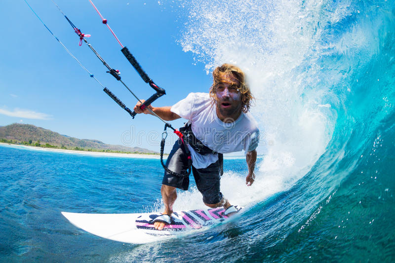 Kite Surfing. Extreme Sport, Kite Surfer Riding Wave getting Barreled stock images
