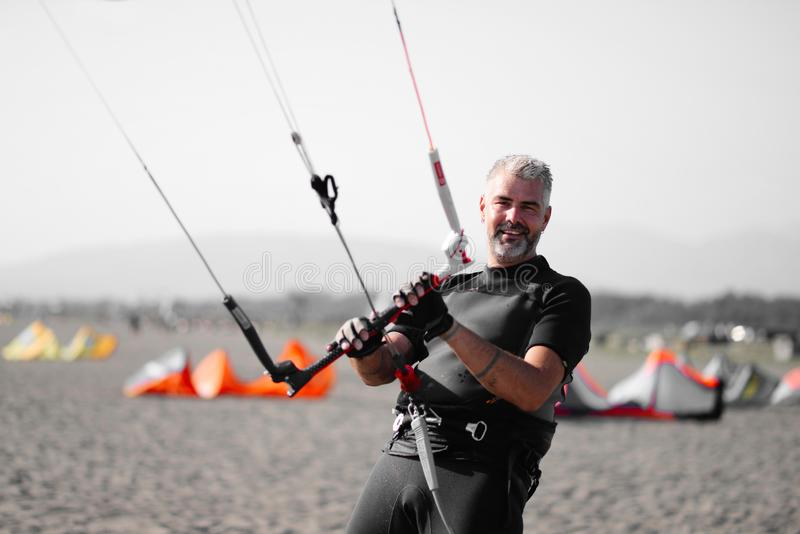 Kite surfing man practicing. royalty free stock photography