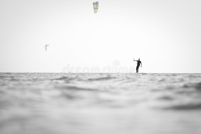 Kite surfing man practicing. royalty free stock photo