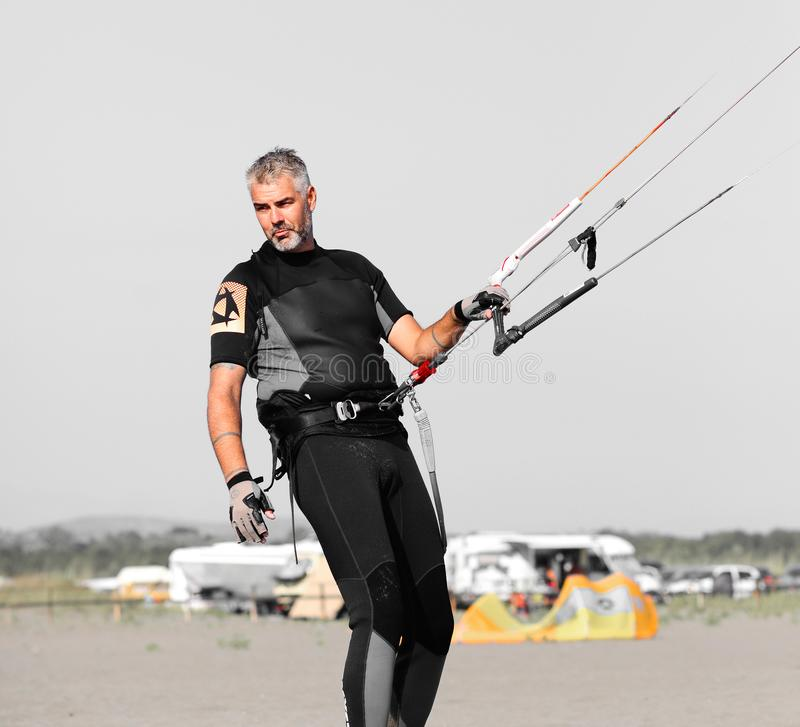 Kite surfing man practicing. stock photography