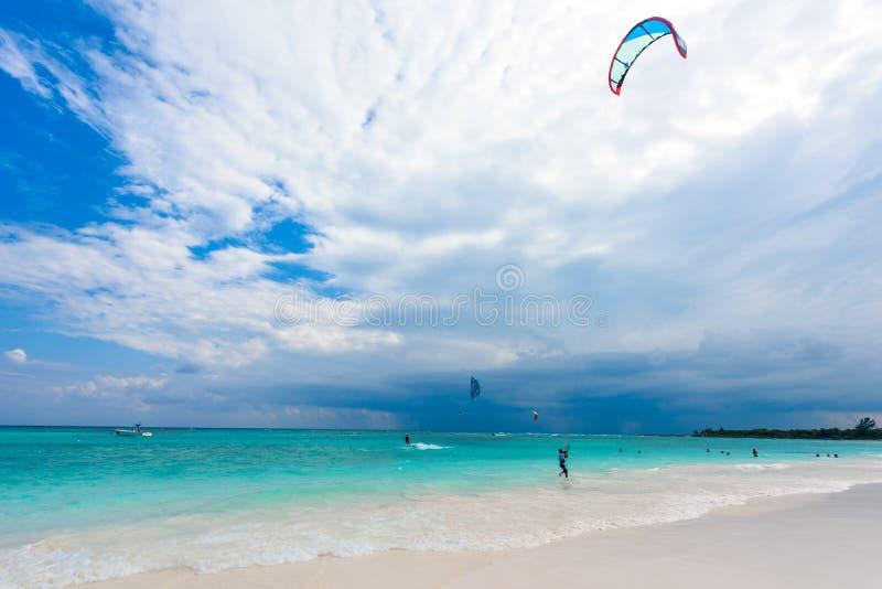 Kite surfing at paradise beach stock photos