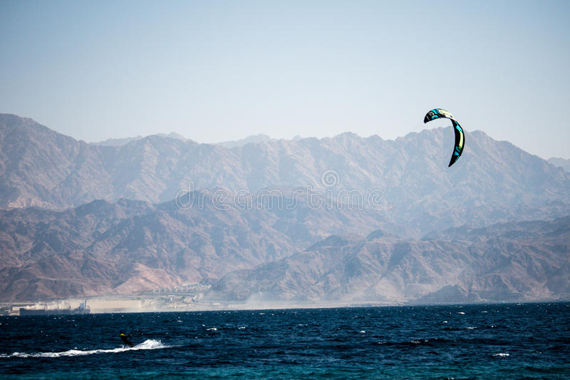 Kite surfing on the Red Sea in Israel and Jordan at background stock images