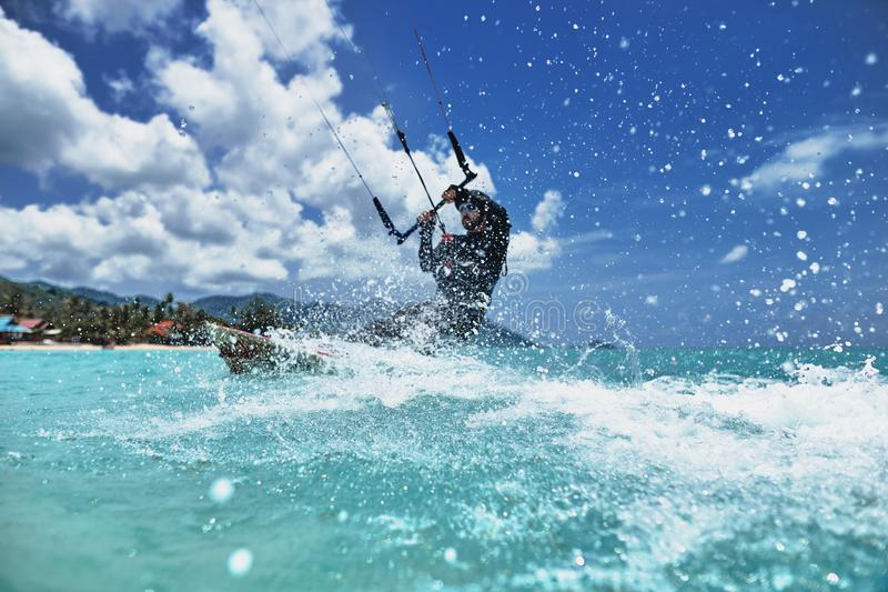 Kite surfing in the sea. A kite surfer rides the waves stock image