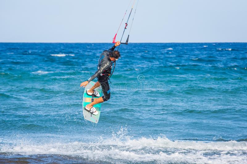 Kite surfing exterme water photography. Kite surfing in a sunny, beautiful day in Tenerife stock photography