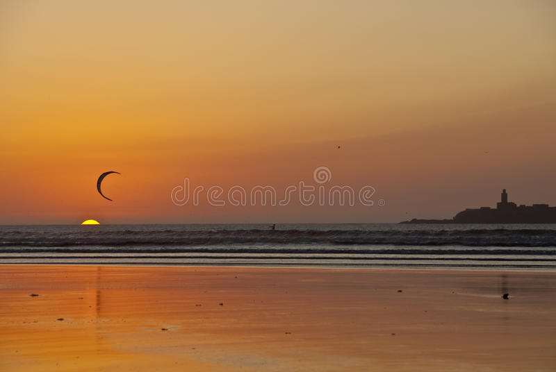 Kite surfing at sunset royalty free stock photography