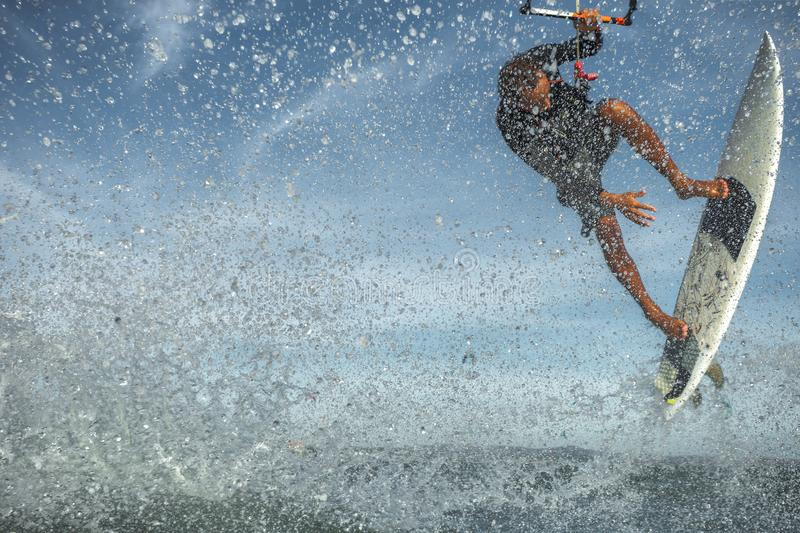 Kite surfing. A kite surfer rides the waves stock images