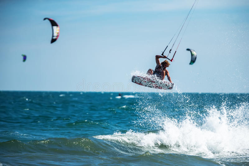 Kite surfing. A kite surfer rides the waves stock photo