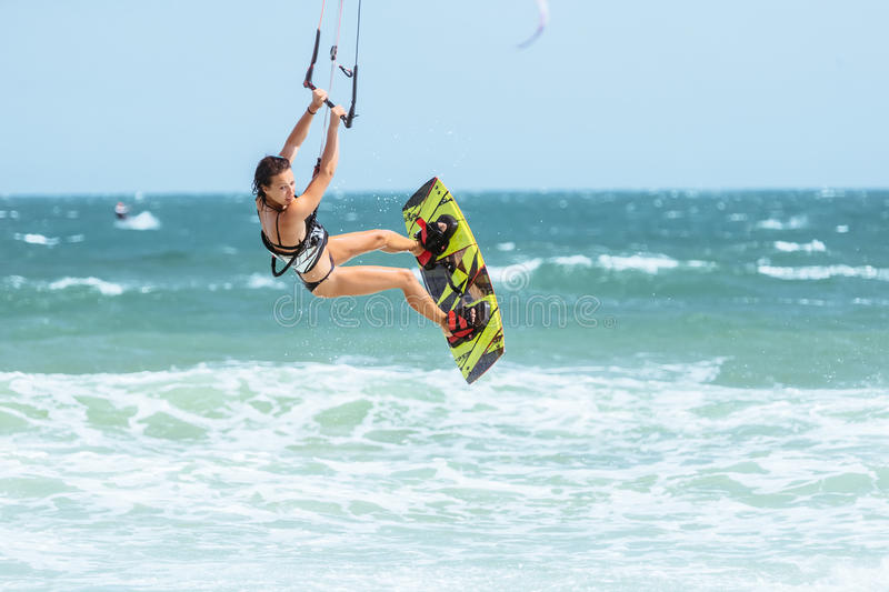 Kite surfing. A kite surfer rides the waves royalty free stock photography