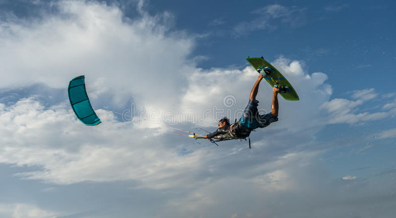 Kite surfing. A kite surfer rides the waves royalty free stock photo