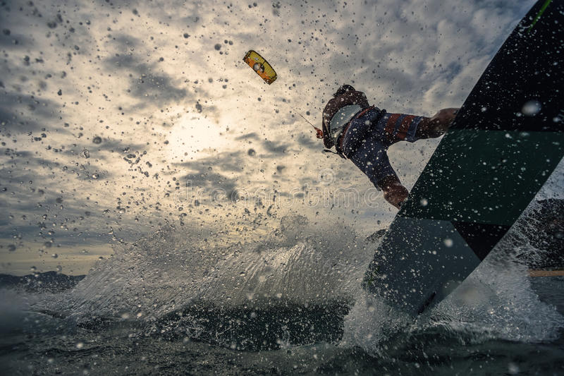 Kite surfing. A kite surfer rides the waves royalty free stock images
