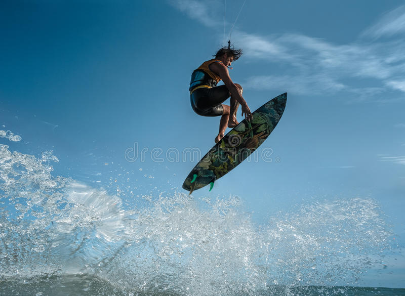 Kite surfing. A kite surfer rides the waves stock photography