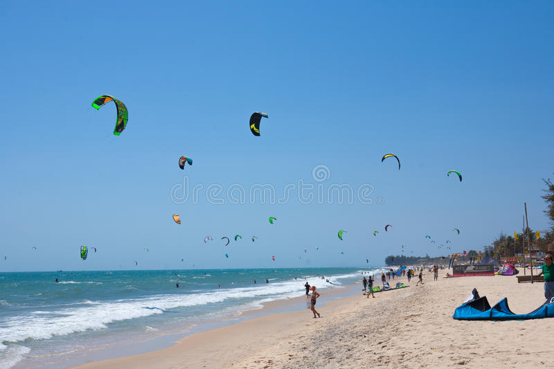Kite surfing. Kite Surfer in a Tropical beach, Mui Ne, Vietnam royalty free stock photography